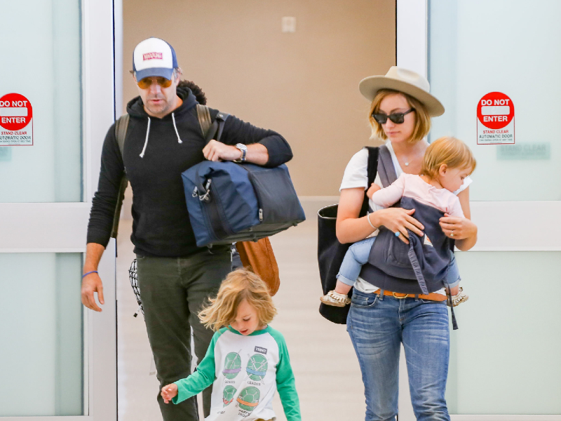 Jason Sudeikis and Olivia Wilde with their children in LAX